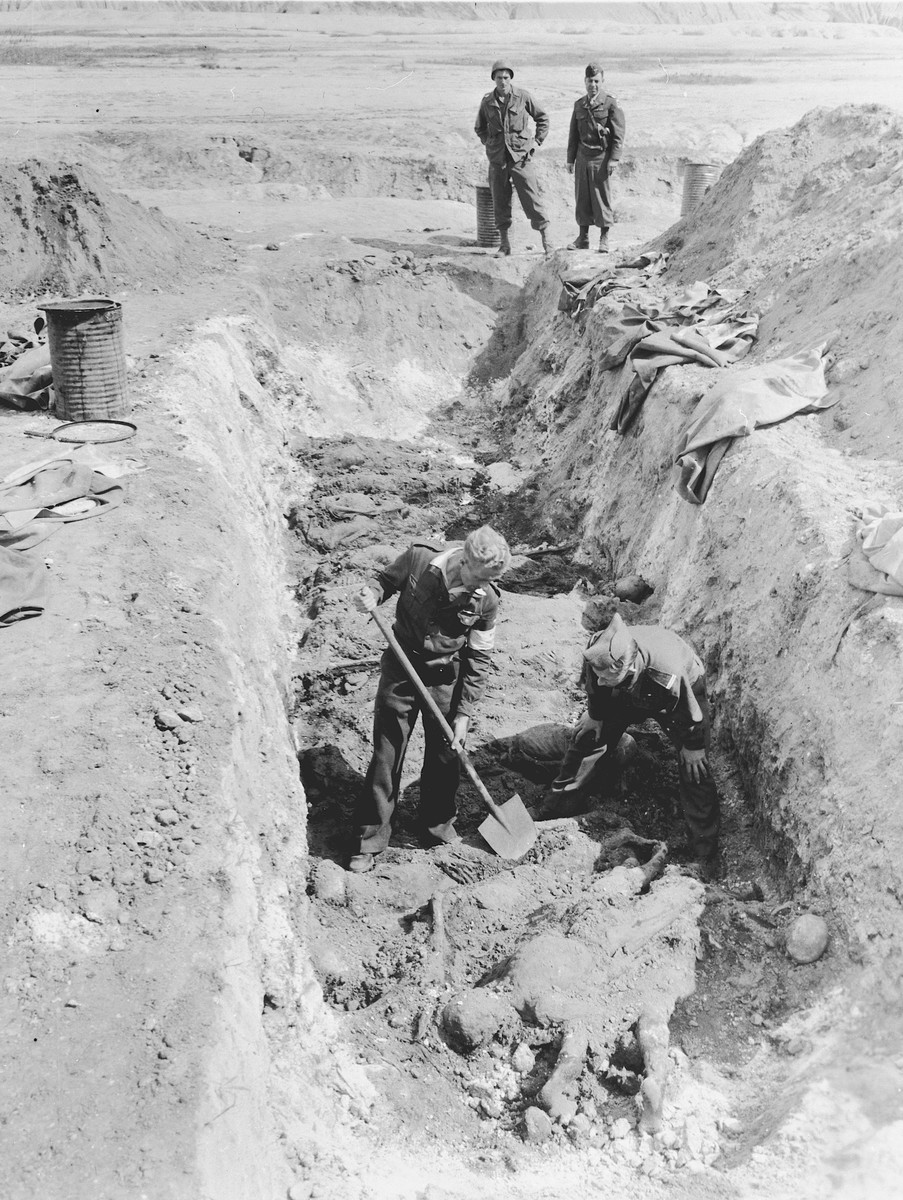 Under the direction of American soldiers, German civilians exhume the bodies of prisoners from a mass grave 14 km. east of Zeitz.  On June 18, 1945, the 7th U.S. Army, 69th Infantry Division was notified about a mass grave near Zeitz.  The grave was discovered by a Dutch soldier who had been a prisoner for three years in the nearby labor camp of Troeglitz, a sub-camp of Buchenwald.  The 400 victims exhumed from the grave were also prisoners of Troeglitz, which provided labor for Brabag (Braunkohle-Benzin AG).  All the victims were male and without identification, except for a few with numbers on their tattered and partly decayed clothing. Civilians from the area claimed that the bodies were buried just before the arrival of U.S. Army troops.