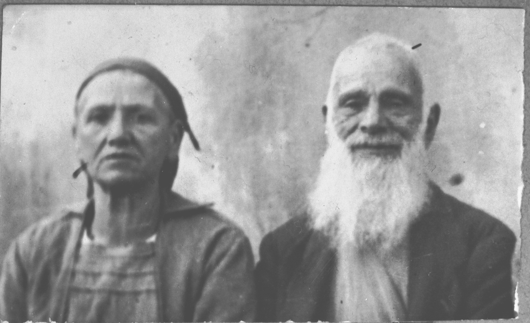 Portrait of Yakov Kamchi, son of Isak Kamchi, and Yakov's wife, Rebeka.  He was a grocer.  They lived at Dr. Raisa 134 in Bitola.