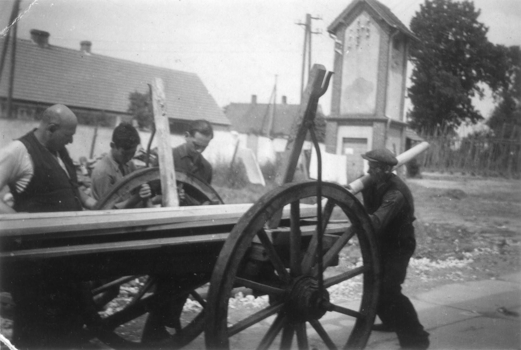 German Jewish youth learn agricultural skills in a training farm outside of Breslau.  From left to right are the carpenter Kiwi, Peter Rosenthal, Rotschild, and a non-Jewish blacksmith.