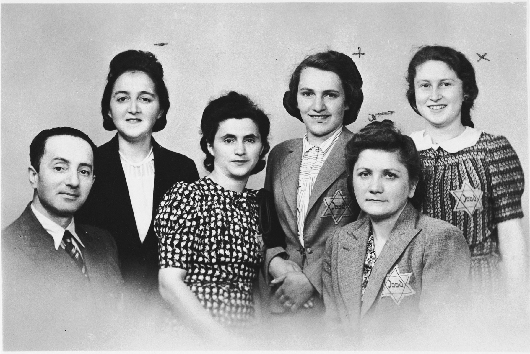 "Group portrait of five Jewish women and a Jewish man, wearing Dutch Star of David badges inscribed with the word ""Jood"".  Pictured from left to right are: Jacob Szwajcer, Regina Malinger, Bajla (Ferens) Szwajcer, Golda Zweifach from Krakow, Klara Ringel from Ukraine and Jadzia Rosen from Warsaw."