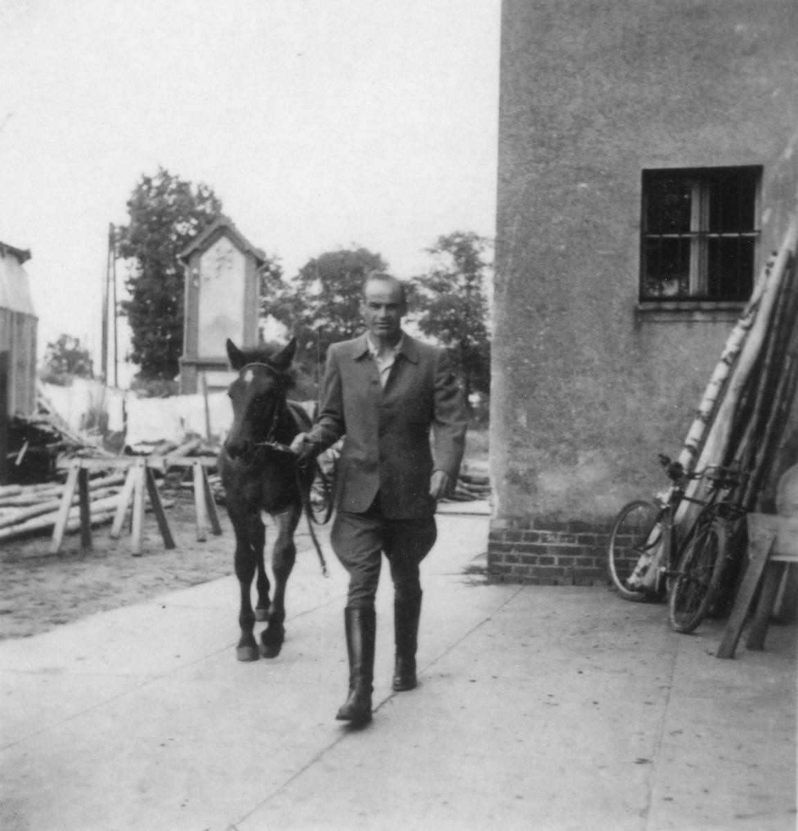 Prof. Dr. Kurt Bondy, director of the Gross Breesen agricultural training center, walks his horse Edgar.  Prior to the Nazi regime, Dr. Bondy had been a professor of jurisprudence in Hamburg.