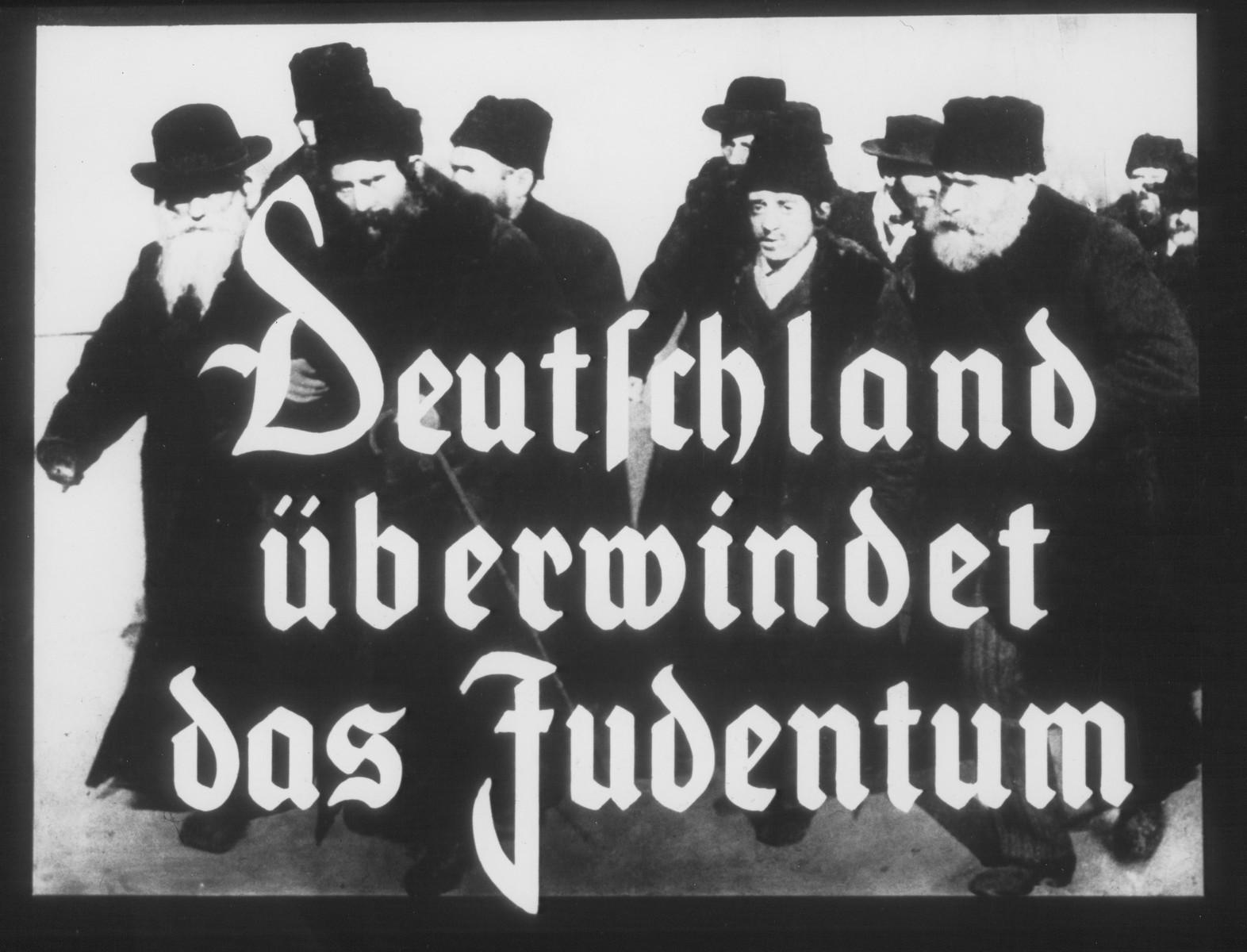 "Propaganda slide entitled ""Germany overcomes Jewry."""