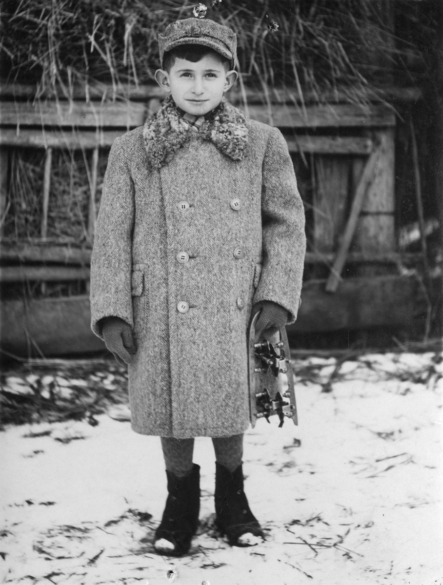 Portrait of a Jewish boy holding a skate in Sokal, Poland.  Pictured is Dov Zugman.