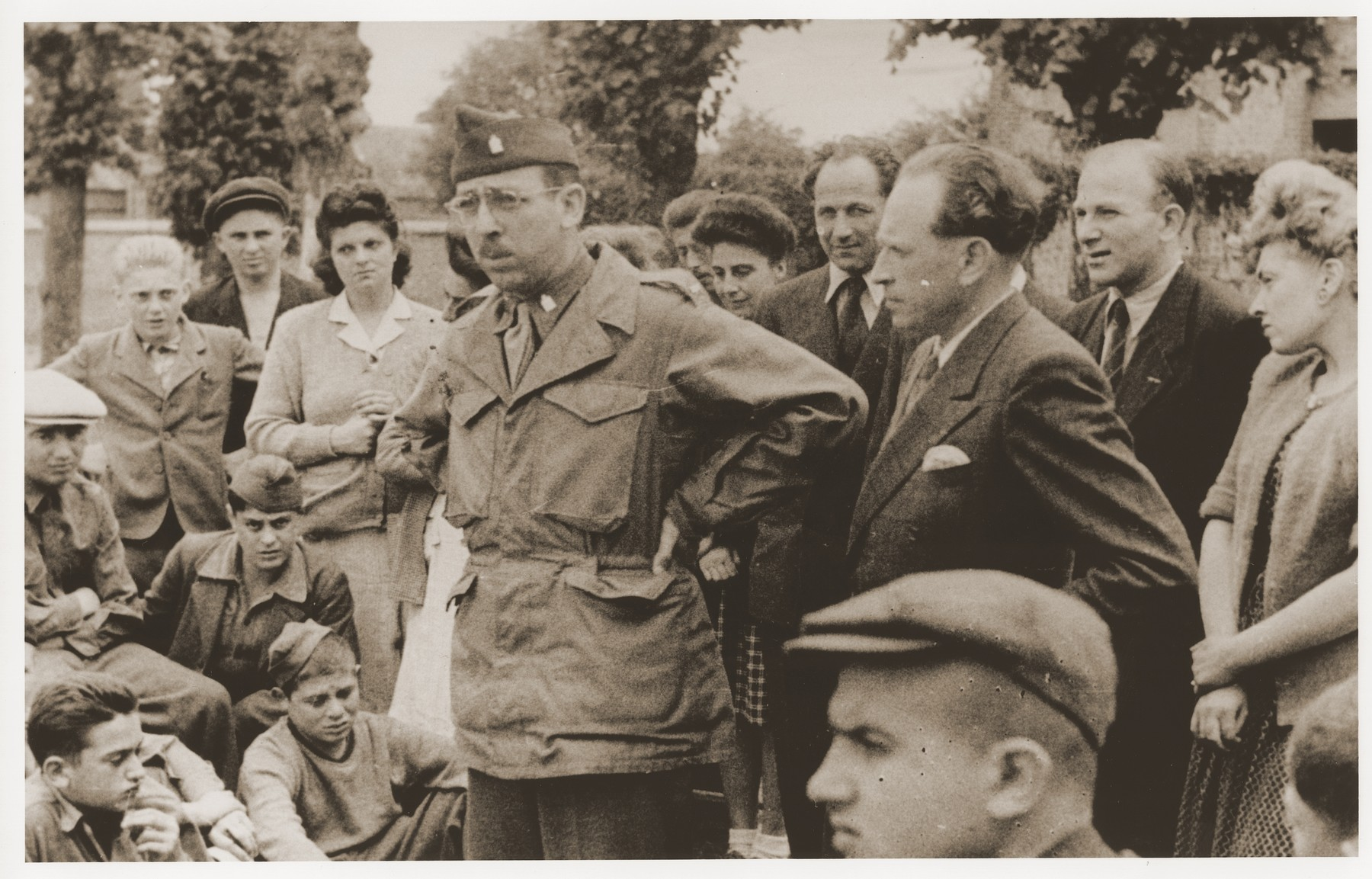 US Army Chaplain Rabbi Morris Dembowitz meets with members of the Buchenwald children's transport outside the Ecouis children's home.   Among those pictured is Hans Oster (second row of children from the bottom, second from the left).