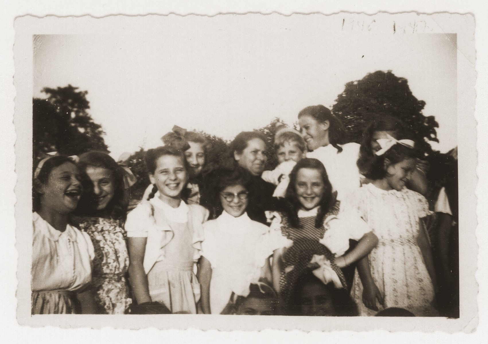 Group portrait of Jewish DP girls living at a children's home in Fublaines under the auspices of Rescue Children, Inc.  Renate Guttmann is pictured fifth from the left in the front.