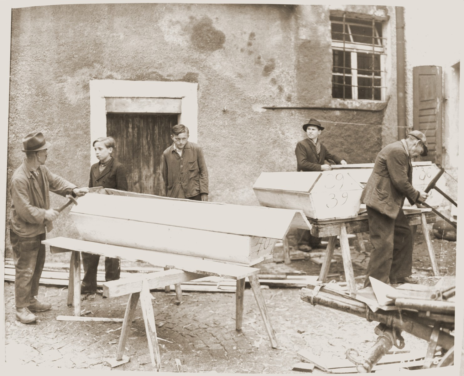 German inhabitants of Neunburg vorm Wald build coffins for Polish, Russian and Hungarian Jews who were killed by the SS in the forest near their town.  The victims were prisoners from Flossenbuerg who were on a death march.
