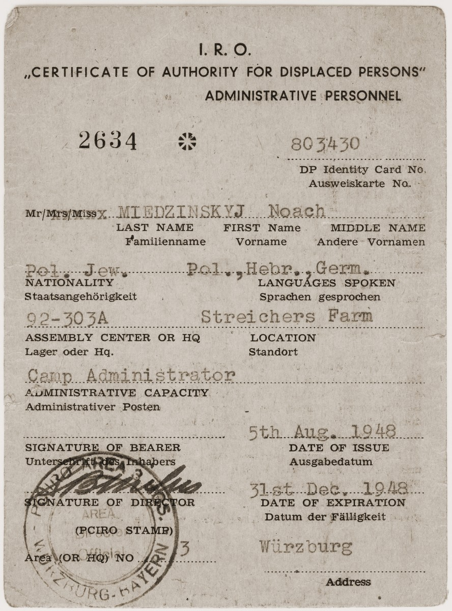 Certificate issued by the International Refugee Organization attesting that Noach Miedzinski is camp administrator of the Kibbutz Nili hachshara (Zionist collective) in Pleikerhof, Germany.