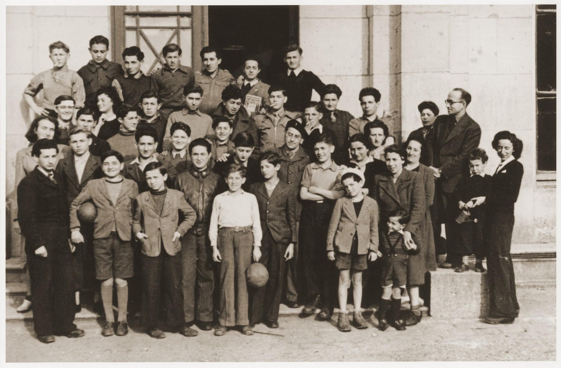 Group portrait of Jewish DP youth and staff at the OSE (Oeuvre de Secours aux Enfants) children's home in Ecouis.  Among those pictured are Nachum Ajzenberg, Elias Balter, Henri Dymant, Andre Dymant, Wolf Fojgel, Gerszon Gerson, Lejzor Grunberg, Max Kozuch, Nachman Klugmann, Léon Lewkowitz, Téodor Lowy, Beniek Mrcwka, Manfred Reingewitz, Salek Sandowski, Abram Schilcott,  Ignac Spett, Romek Wajsman, Lolek Weinstein.  [See enclosed sheet for precise identification.]