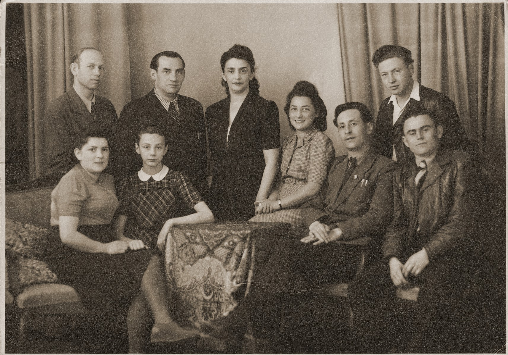 Group portrait off Jewish DPs living in the city of Bayreuth.  Among those pictured standing are Feliz Kozywoda (William's uncle, second from the left) and Welek Luksenburg (right).  Seated (second from the left, the daughter of Moniek Merin) is Helinka Merin, standing in the center is Maryska Gancwiach (the first wife of Moniek Merin).