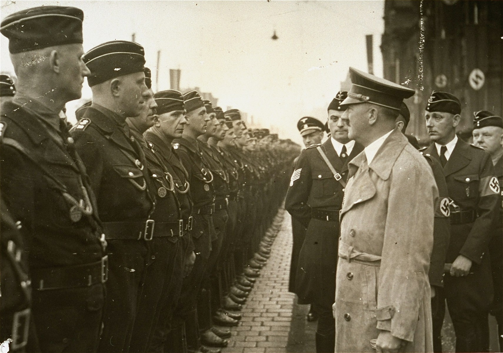 Hitler reviews a unit of workers during Reichsparteitag (Reich Party Day) celebrations in Nuremberg.
