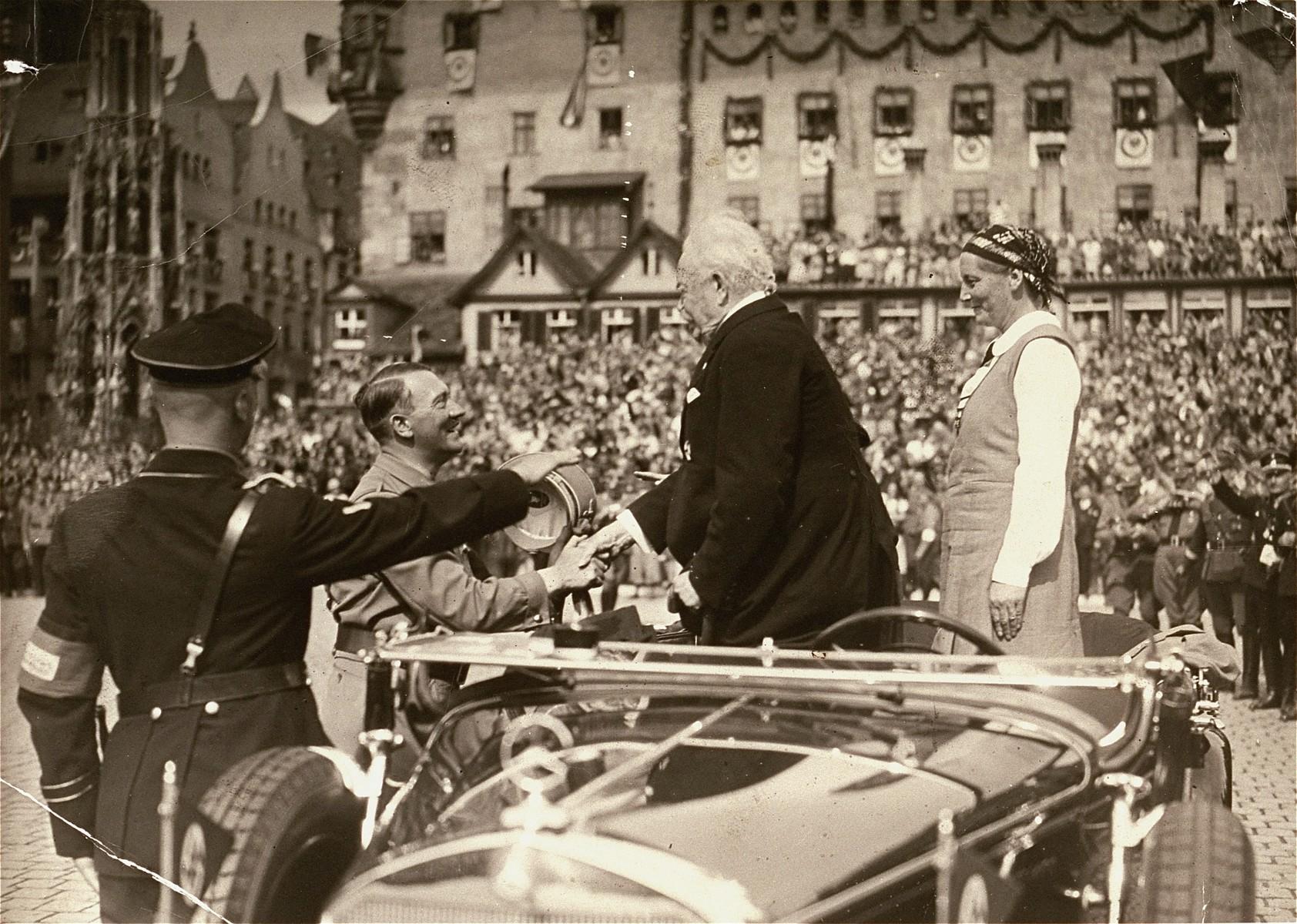 Adolf Hitler greets General Karl Litzmann on the Adolf Hitler Platz during Reichsparteitag (Reich Party Day) ceremonies in Nuremberg.