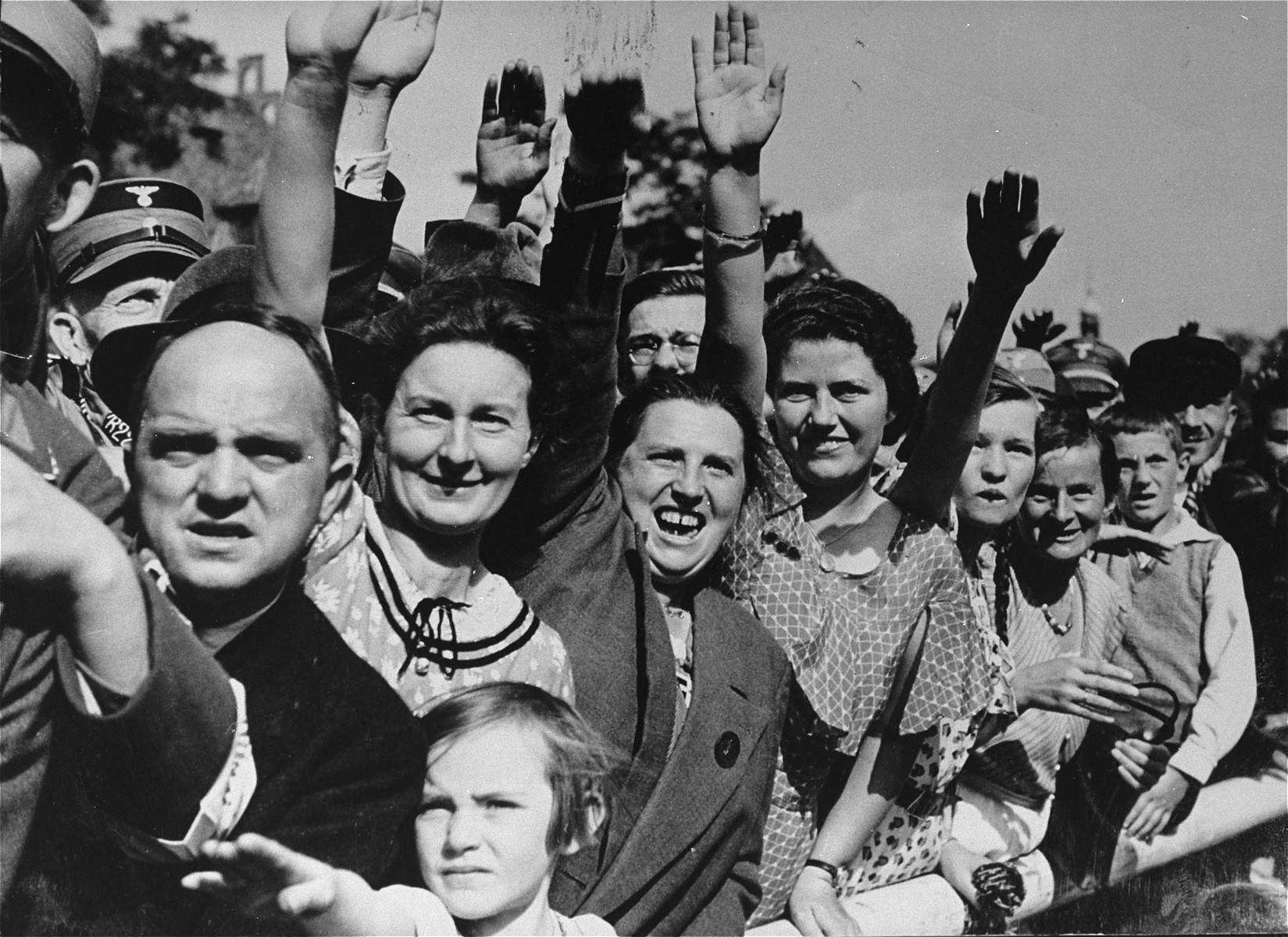 German spectators give the Nazi salute as they watch a Reichsparteitag (Reich Party Day) parade in Nuremberg.
