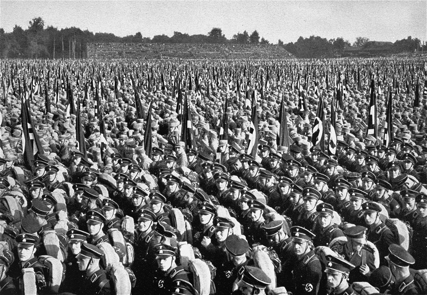Members of the SA and SS stand in formation during  Reichsparteitag (Reich Party Day) ceremonies in Nuremberg.
