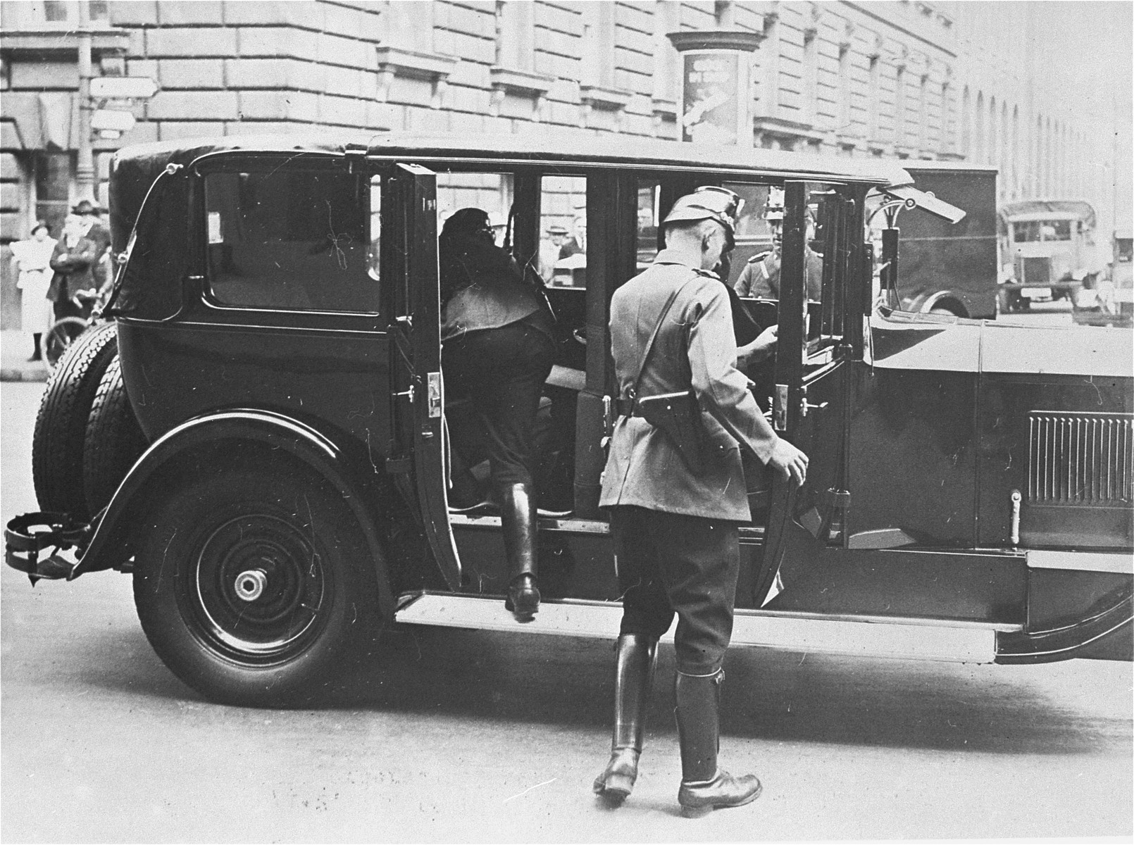 Police search a vehicle for weapons after the Gestapo ordered on 25 July 1933 that all vehicles in Prussia be inspected for arms.    All the other German states enacted a similar policy and conducted searches of trains, cars, and other vehicles.