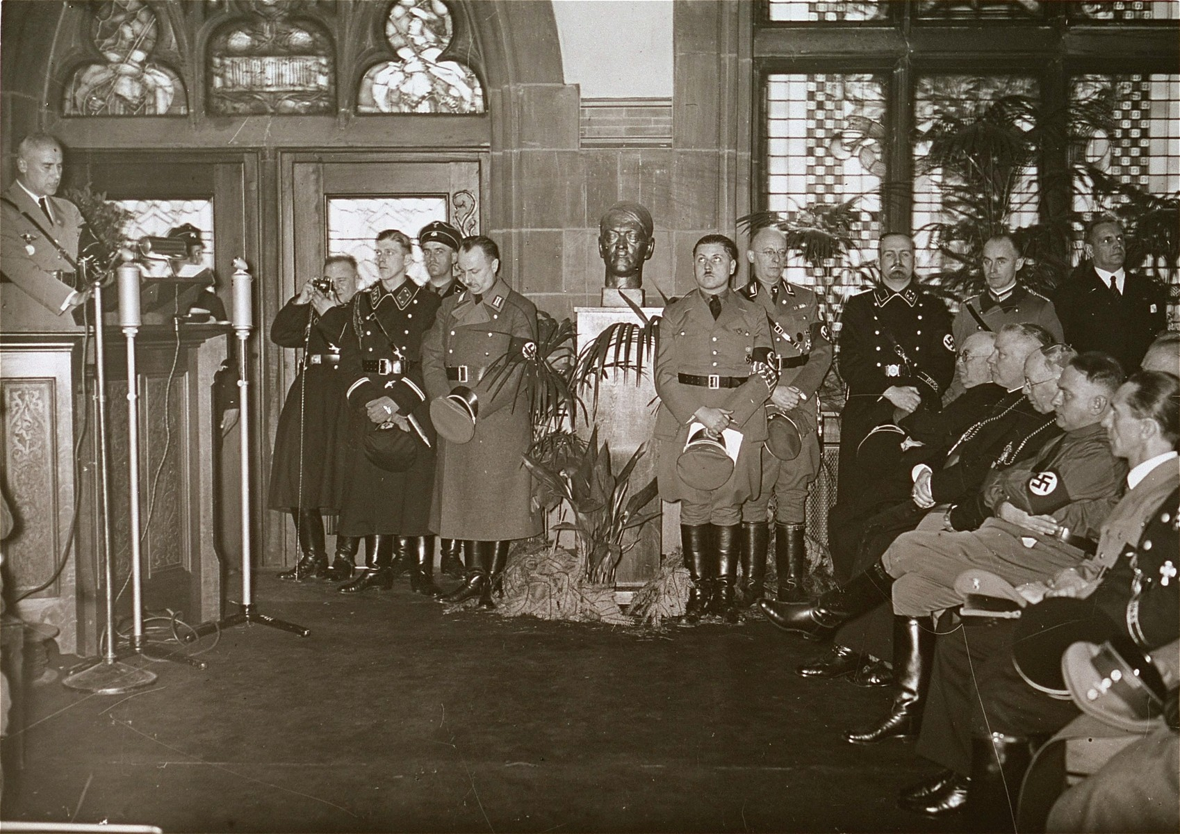 Nazi officials and Catholic bishops listen to a speech by Wilhelm Frick, Reich Minister of the Interior, at an official ceremony in the Saarbrucken city hall marking the re-incorporation of the Saarland into the German Reich.  Among those pictured is Joseph Goebbels (seated at the far right), Franz Rudolf Bornewasser (Bishop of Trier) and Ludwig Sebastian (Bishop of Speyer).