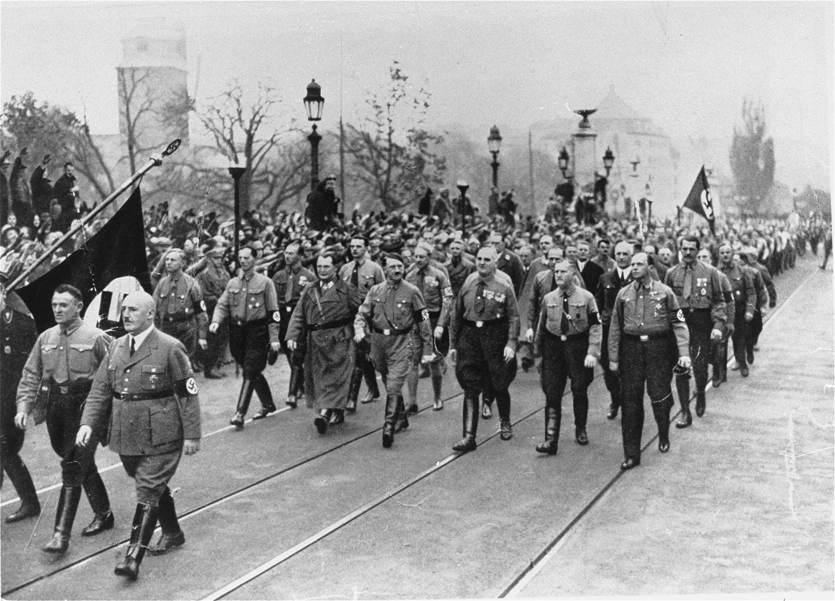 """Adolf Hitler, Hermann Goering, Julius Streicher, and other """"old fighters,"""" retrace the route of the march in 1923 during ceremonies commemorating the eleventh anniversary of the """"beer hall putsch."""""""