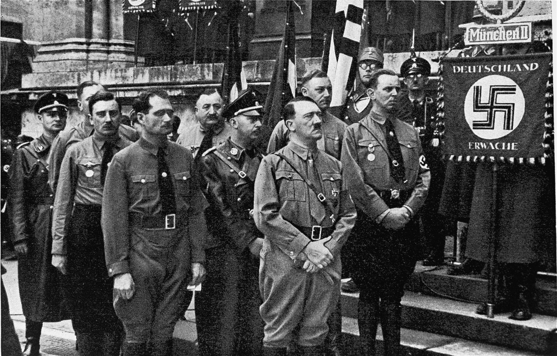 """Hitler, Hess, Himmler and others in front of the """"Feldherrnhalle"""" during a ceremony commemorating the eleventh anniversary of the """"Beer Hall Putsch""""."""