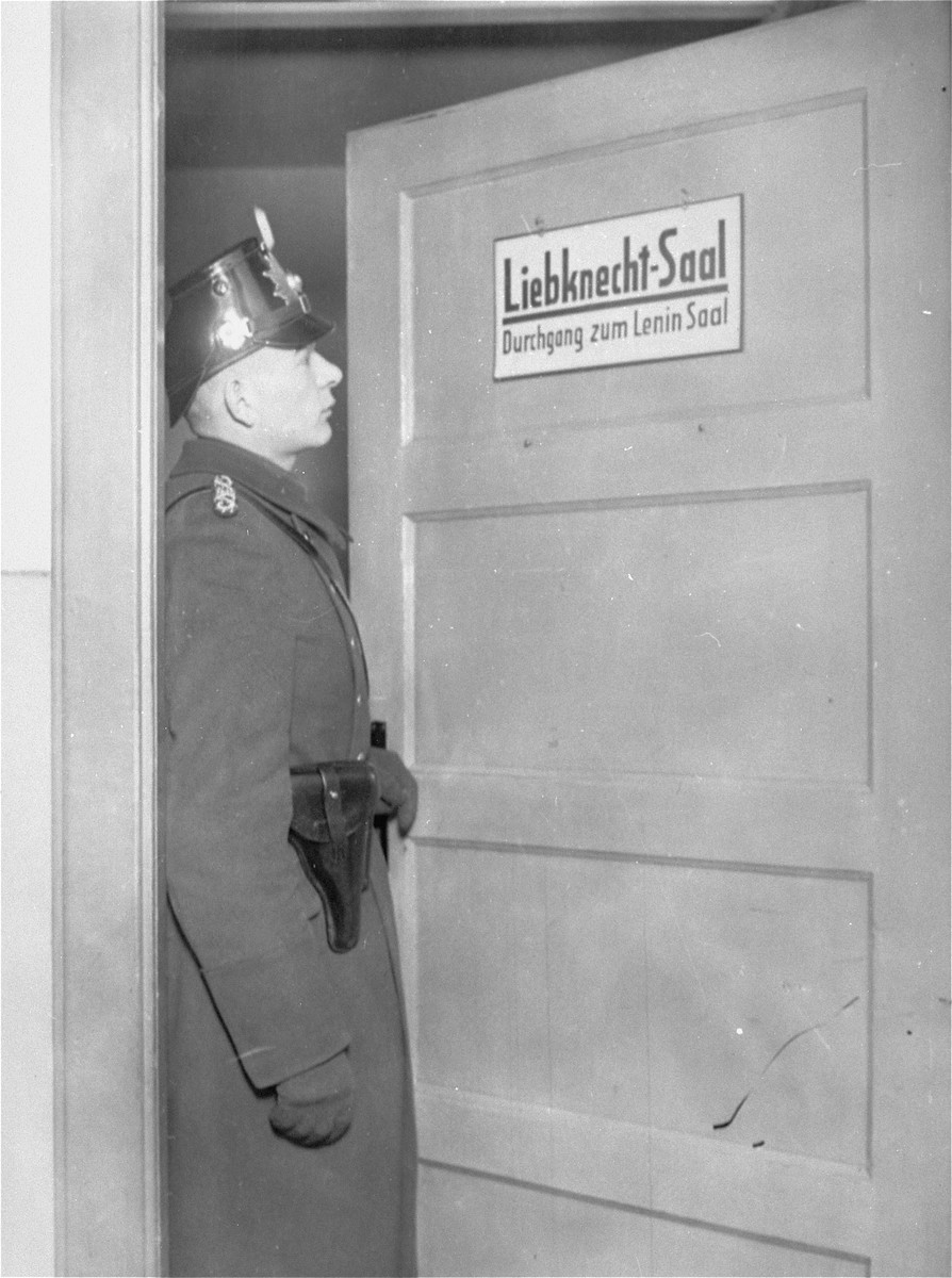 A member of the Schutzpolizei stands at the door of the Liebknecht Hall during the closing of the Karl-Liebknecht House, (KPD headquarters) which was on the Buelowplatz in Berlin.    The closing of Communist Party offices was declared necessary for the protection of the state in the Enabling Act, passed by the Reichstag soon after the fire of 28 February 1933.