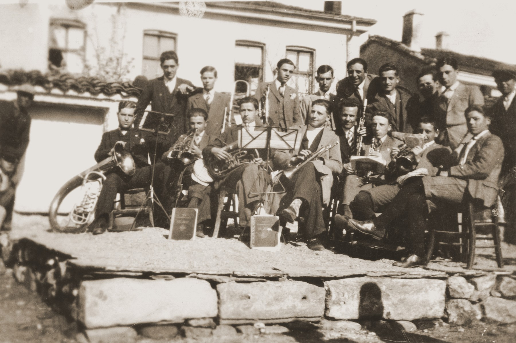 A group of Macedonian Jewish youth who are members of a band, pose with their instruments on a makeshift stage in Bitola, Macedonia.