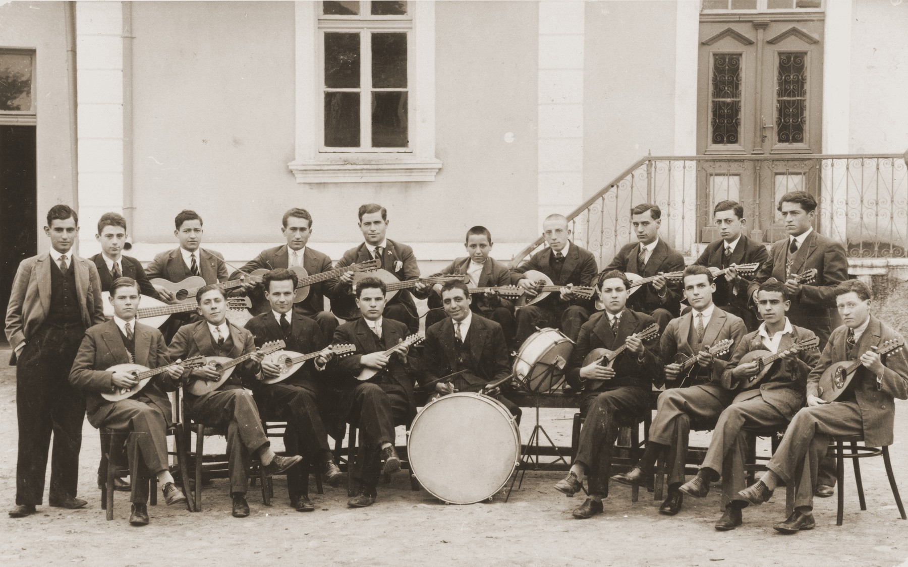 A group of Macedonian Jewish youth who are members of a mandolin band, pose outside a building in Bitola, Macedonia.