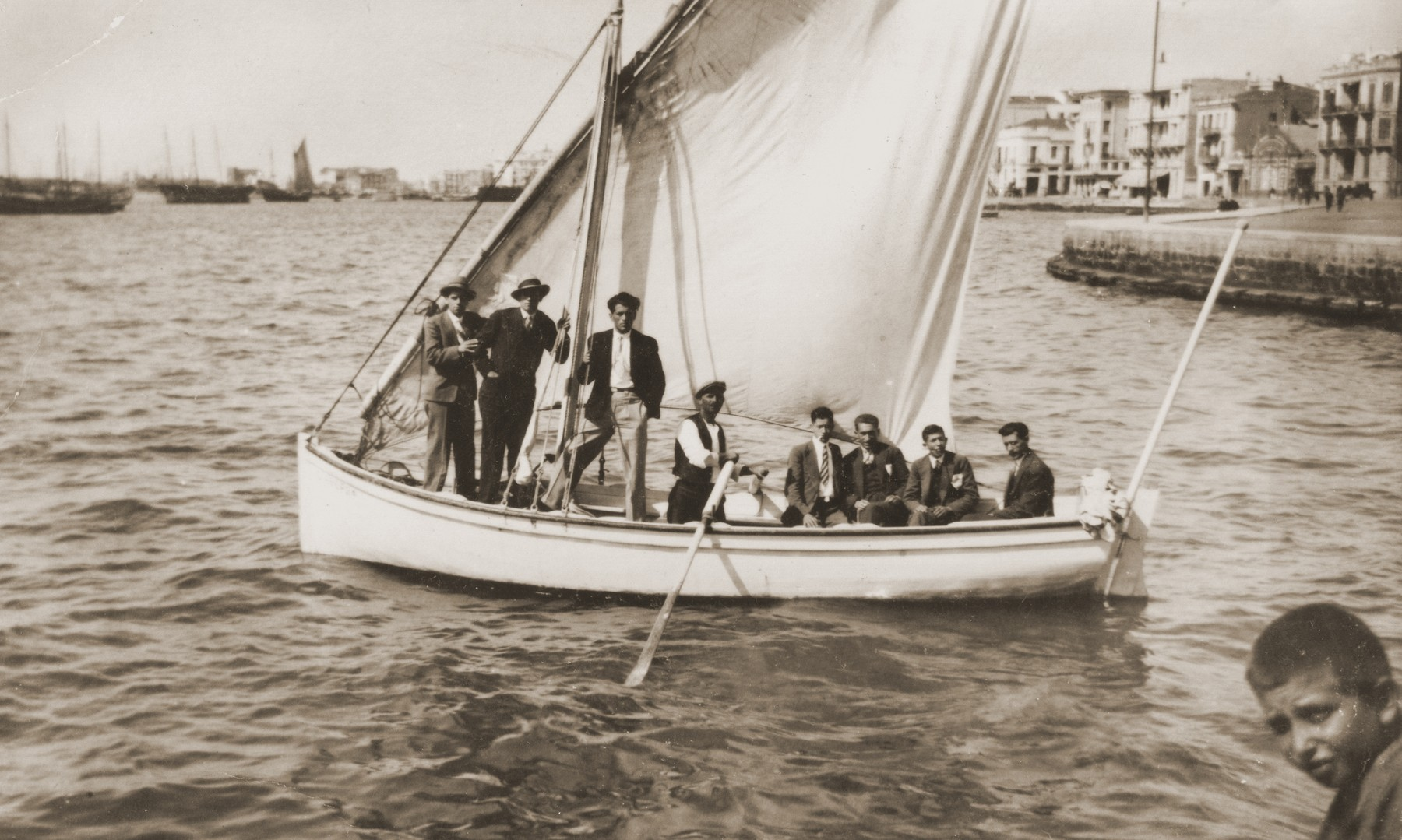 Jewish youth on a sailboat in Salonika harbor.