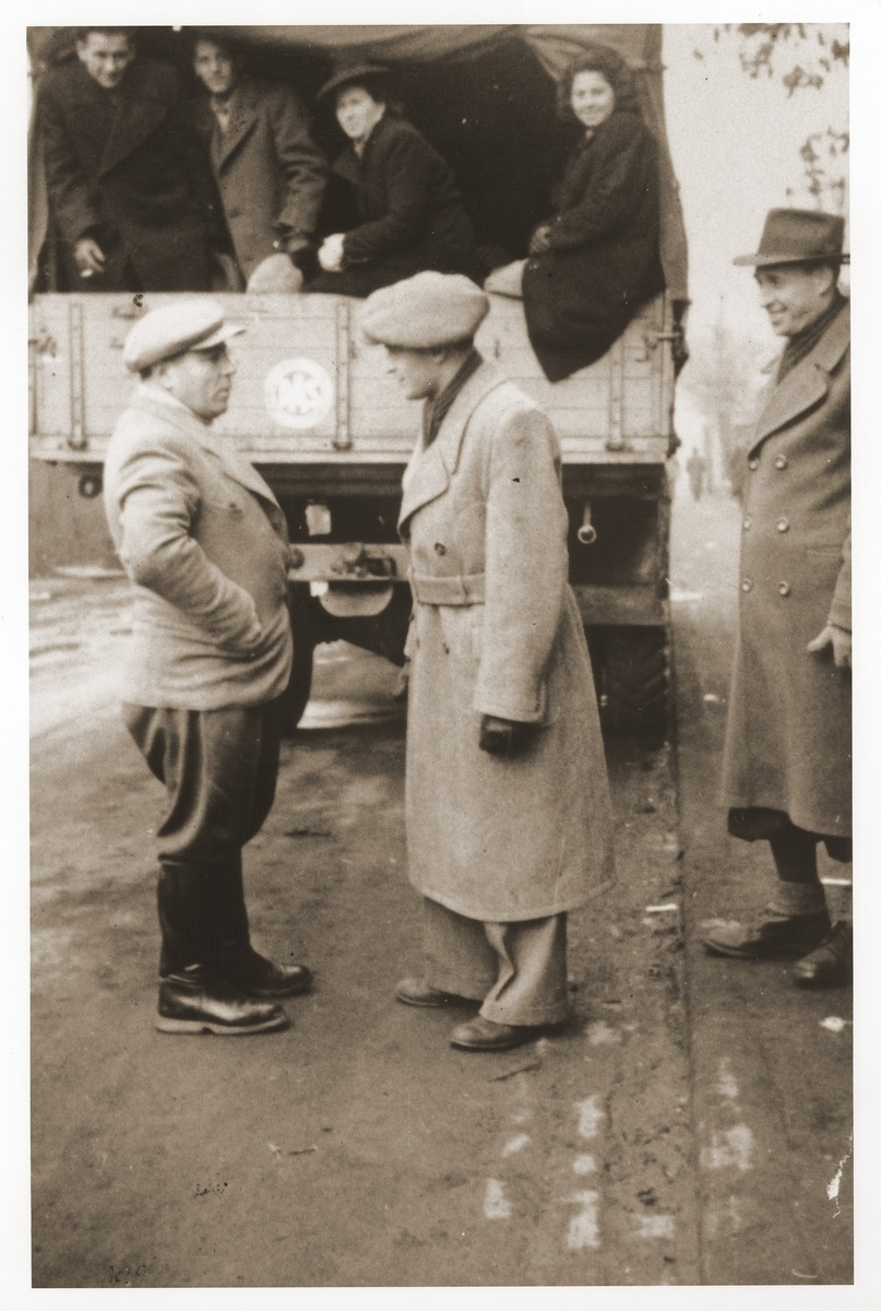 DPs riding on the back of a truck leave the Belsen displaced persons camp for France, where they will sail aboard the Exodus 1947 to Palestine.  Szaja Aron Knobler (now Alex Knobler) is the son of Moszek and Jocheta Knobler.  He was born in 1921 in Bedzin, Poland.  Szaja had three older sisters, Ita, Esther and Leah.  In 1931 the family moved to Chorzow near the German border.  There Szaja became active in the Akiba Zionist youth movement.  In 1938 he joined the Akiba hachshara [agricultural training farm] in Bielsko and made plans to immigrate to Palestine.  His plans were thwarted, however, by the start of World War II.  In the first months of the war Szaja fled to the Soviet sector of Poland, where he explored possible exit routes to Palestine via Romania for the nascent Zionist underground.  During a visit home in 1940 Szaja was caught up in the forced resettlement of his family to the Sosnowiec ghetto.  From Sosnowiec Szaja was deported to the Blechhammer labor camp, where he remained until the camp was evacuated in January 1945.  During the forced march out of the camp Szaja ran away with two friends.  German guards shot and killed his friends but Szaja escaped.  Posing as a Polish laborer, Szaja found refuge with a German farmer in Gleiwitz until liberation.  After the war Szaja, who was the sole survivor of his immediate family, took a leading role in the setting up of Zionist collectives in Poland.  He also was active in the Bricha and Aliyah Bet [illegal immigration to Palestine] movement.  This activity led to his arrest in Sosnowiec by the NKVD.  Following his release from prison, Szaja left Poland for Germany.  During the summer of 1945 Szaja organized Zionist activities at the Foehrenwald displaced persons camp.  In October he moved on to the Bergen-Belsen DP camp, where he joined a group of 400 would-be immigrants to Palestine.  The group sailed aboard the Tel Hai from Marseilles in March 1946.  When the ship reached Palestine, it was intercepted by t