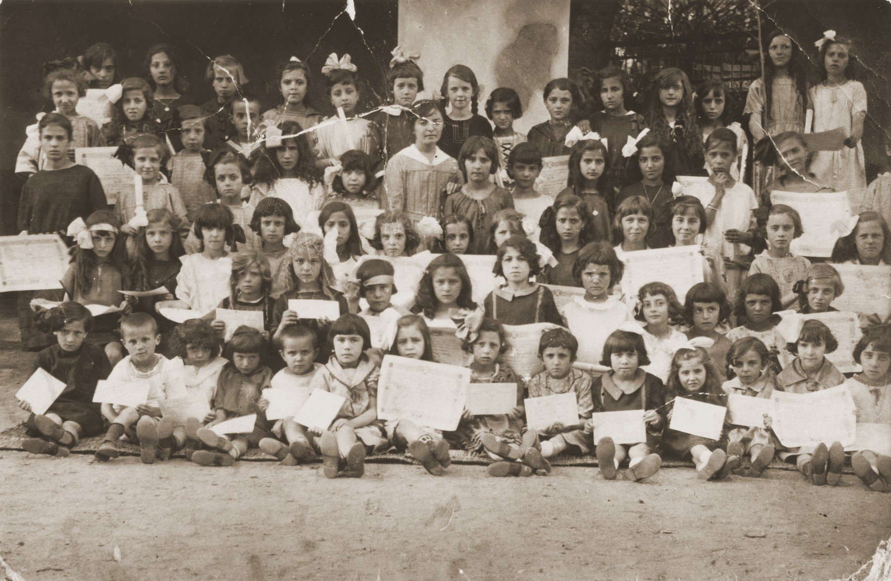 Group portrait of children holding their diplomas at a school in Bitola, Macedonia.