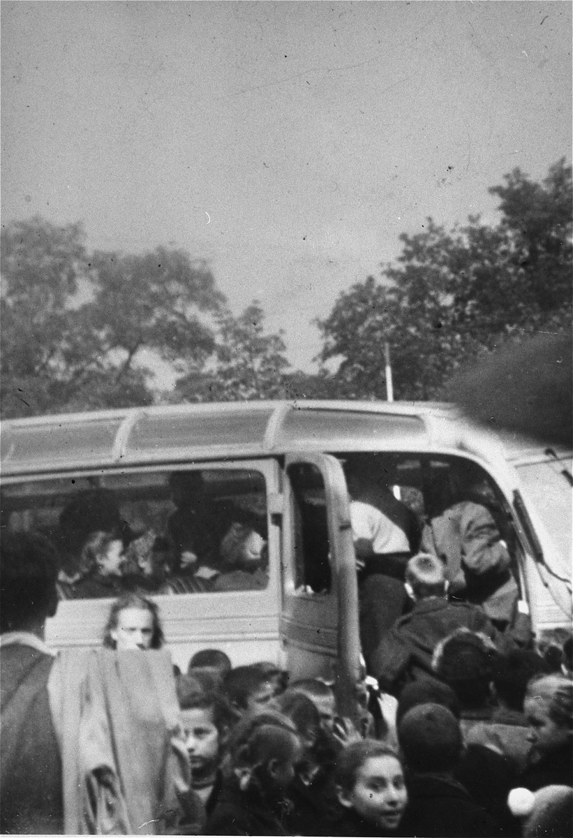 "Members of the Zionist youth group ""Hashomer Hatzair"" board a bus to Germany at  the Polish-Czech border."
