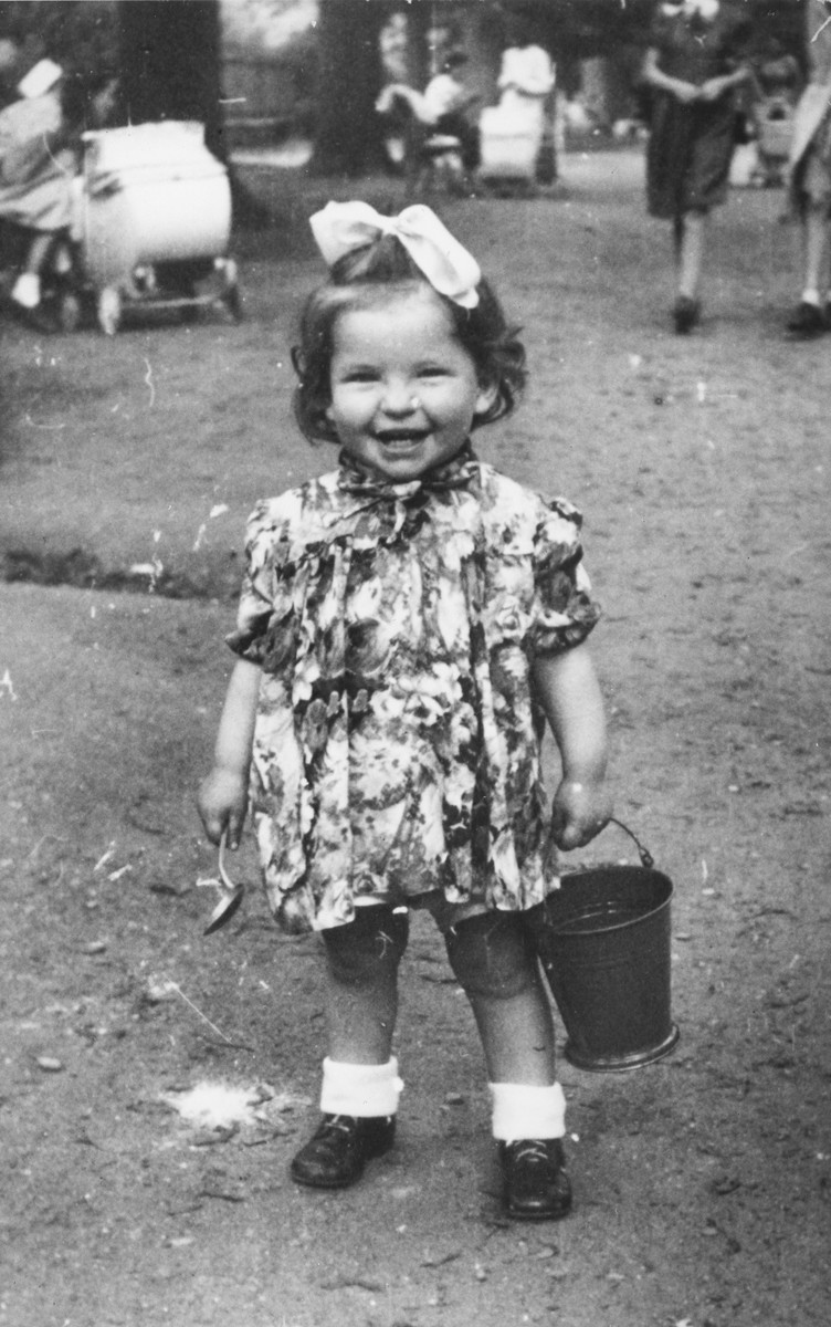 Portrait of a young toddler, Faigele (Angelika) Sztodoszka, with a bucket and spoon.