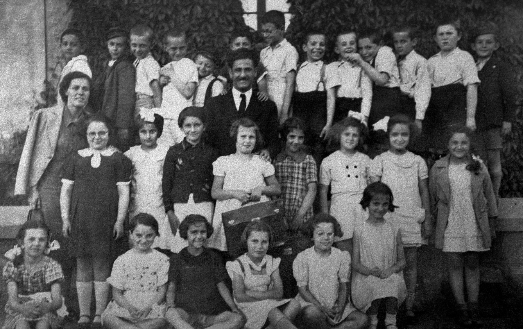 Class portrait of the second grade pupils at the American school in Sofia, Bulgaria.  Among those pictured is Israel Baruch (top row, second from the right).