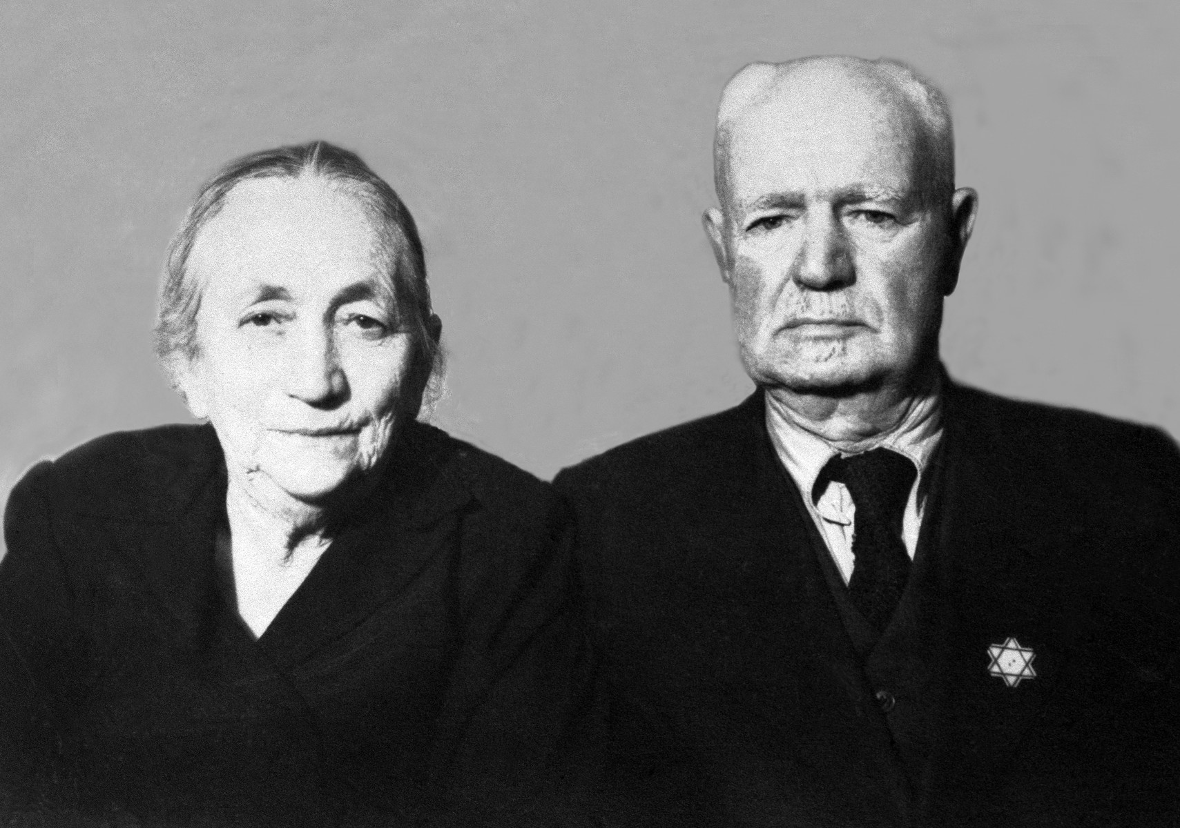 Portrait of an elderly Jewish couple in Kyustendil, Bulgaria, following their expulsion from the capital, Sofia.  Pictured are Miriam and Pinkas Baruch.  During the period of their exile in the provinces, the members of extended Baruch family lived in the home of Miriam and Pinkas Baruch, who had retained their house in Kyustendil after moving to Sofia in the 1930s.
