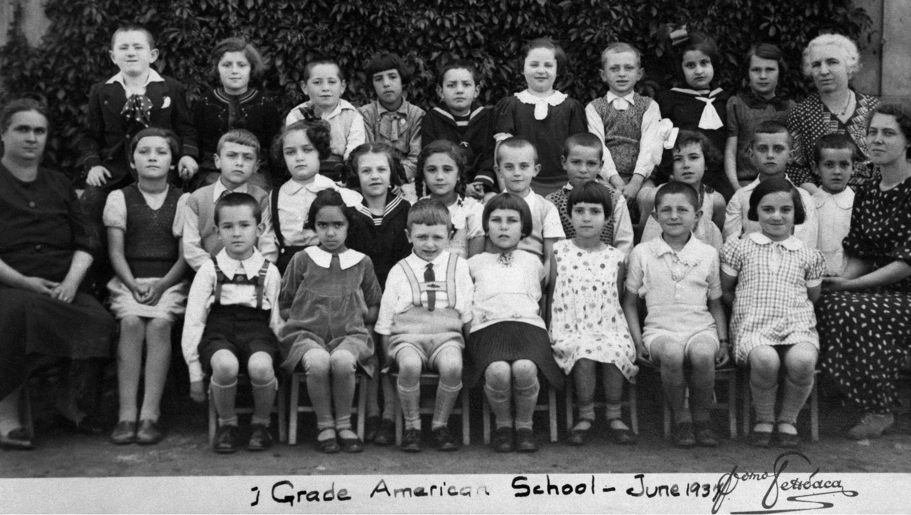 Class portrait of the first grade pupils at the American school in Sofia, Bulgaria.  Among those pictured is Israel Baruch (top row, left).