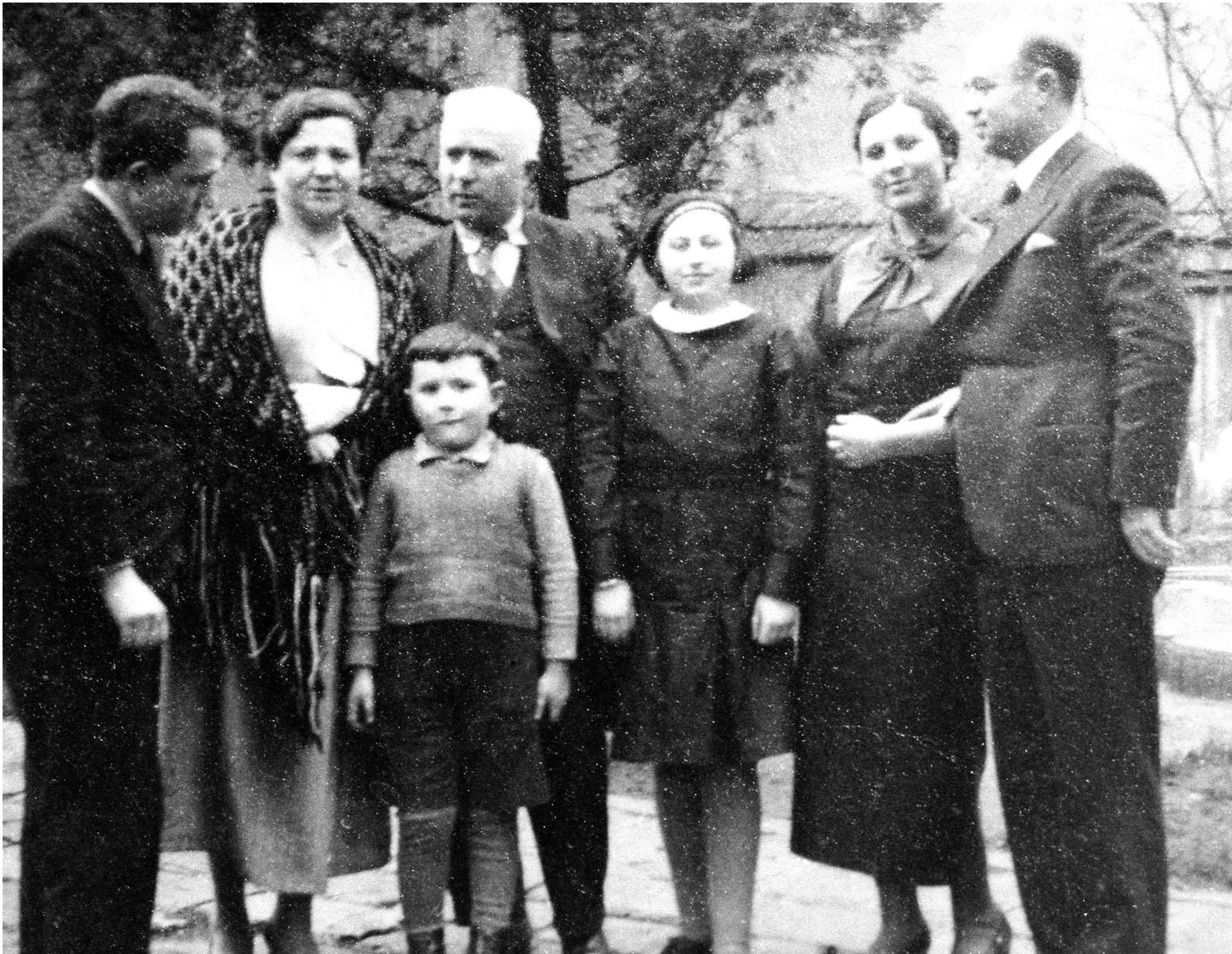 Members of the extended Baruch family pose outside one of their homes in Sofia, Bulgaria.  Pictured in front is Israel Baruch.  Behind him from left to right are: Leon, Rachel, Yako, Marietta, Esther and Joseph Baruch.