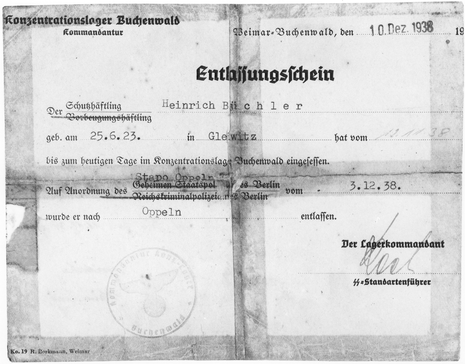 Release certificate issued to Heinrich Büchler.  The document states that Heinrich Büchler was born on June 25, 1923 in Gleiwitz and was sent to Buchenwald on November 12, 1938.  He was released to protective custody in Oppeln.  The document was signed by the commadant of Buchenwald.