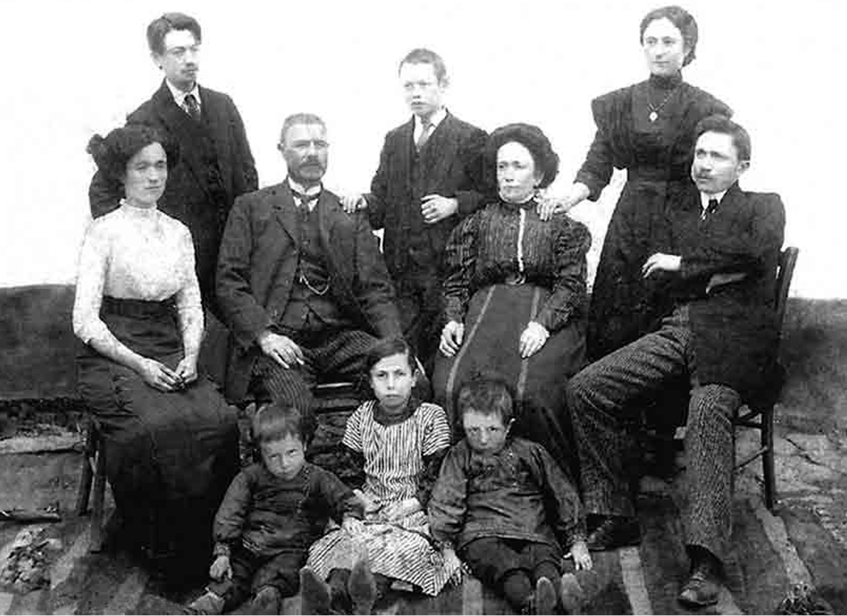 Portrait of a Jewish family in Kyustendil, Bulgaria.  Pictured are Pinkas and Miriam Baruch (the grandparents of Israel Baruch) and their eight children.  Standing from left to right are: Samuel, Joseph and Victoria Baruch.  Seated in the middle row, from left to right, are: Kadena, Pinkas, Miriam and Yako Baruch.  Sitting on the floor, from left to right, are: Fidel, Oretta and Leon Baruch.