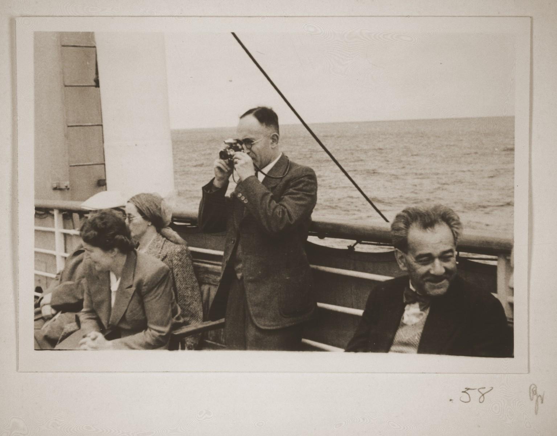 Ernst Vendig shoots photographs on board the St. Louis.