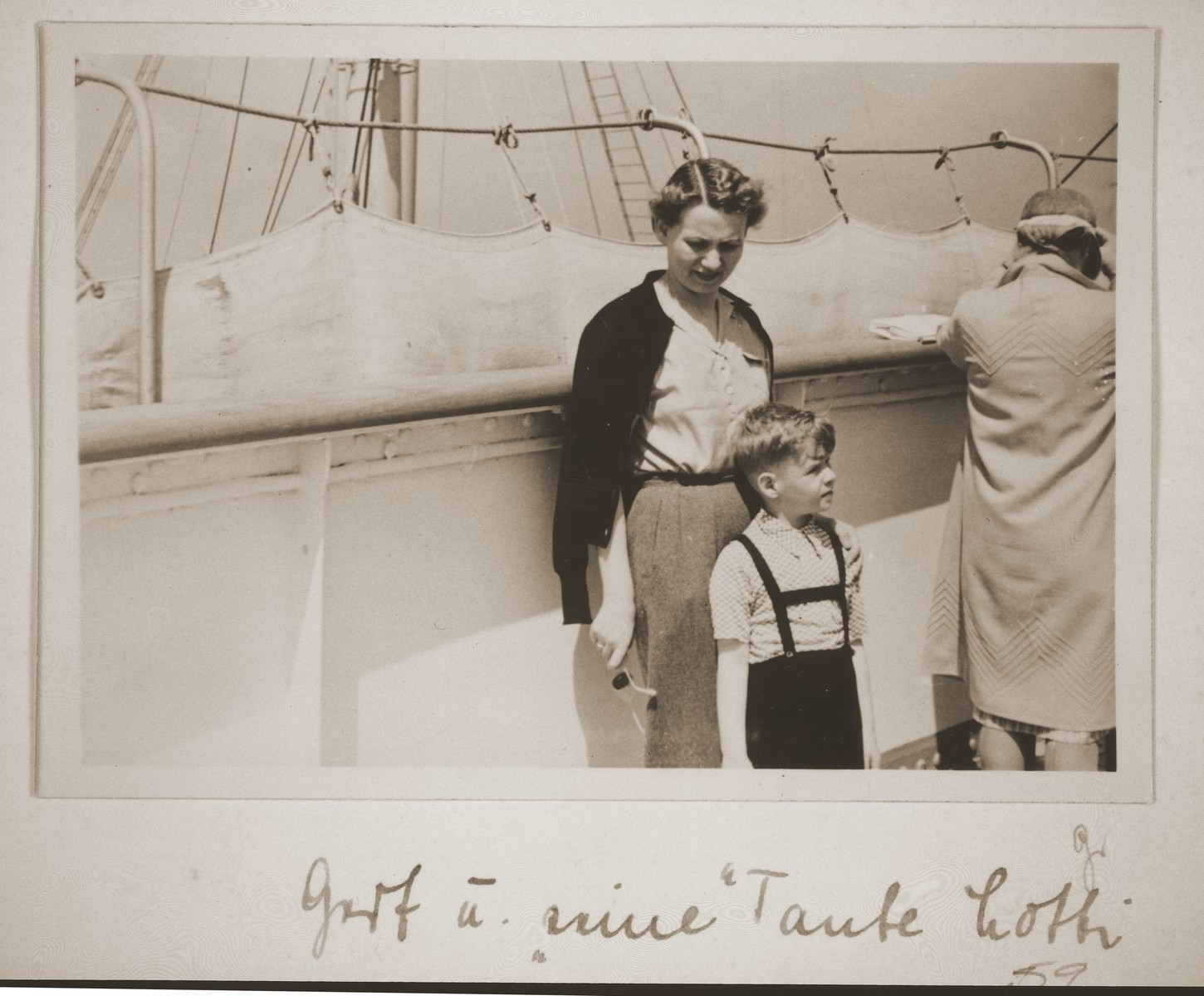 Charlotte Vendig and Gerd-Fritz Grunstein on board the MS St. Louis.  The caption on the photo reads: Gert and his 'Aunt Lotte'.