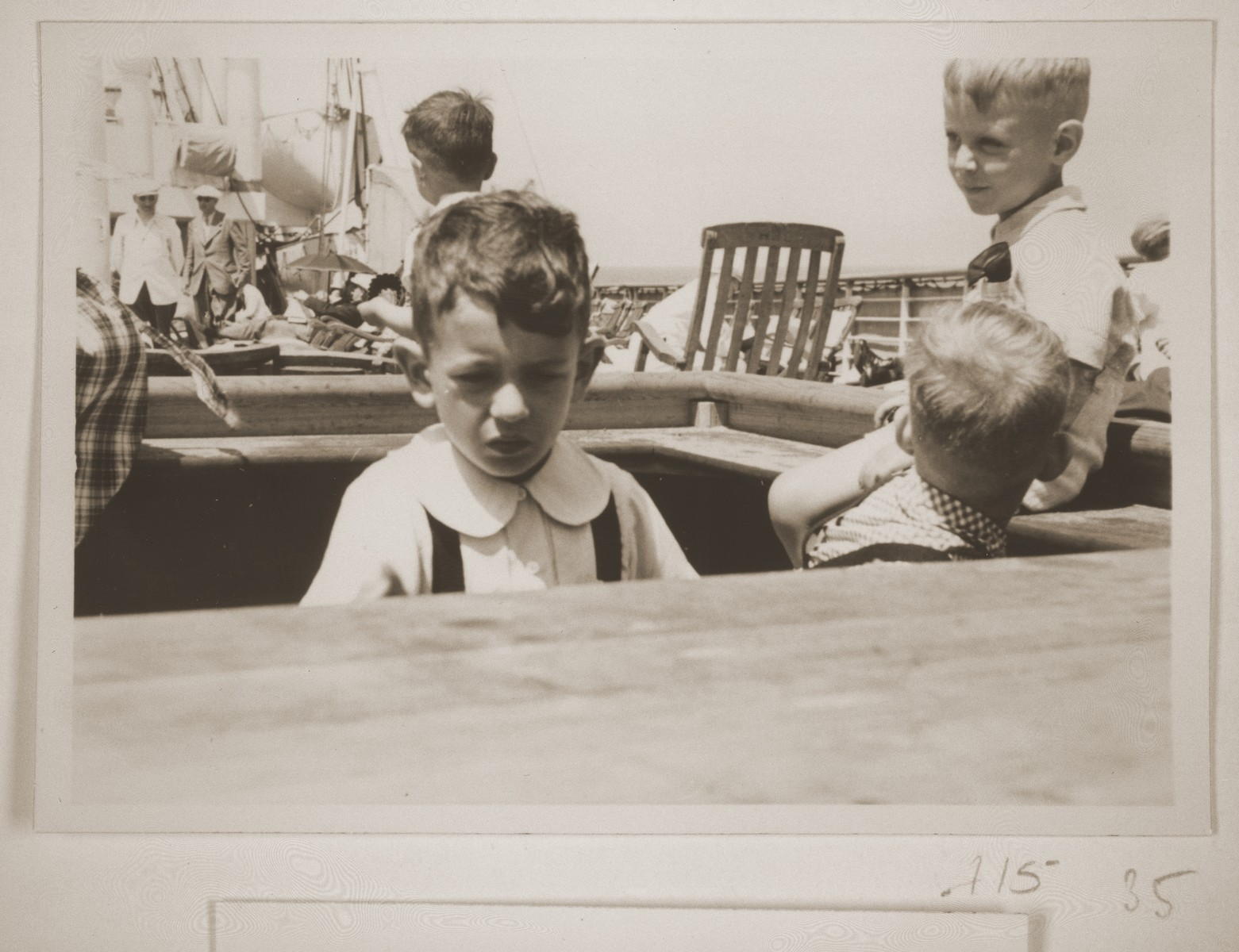 The Vendig children play on an outer deck of the MS St. Louis.