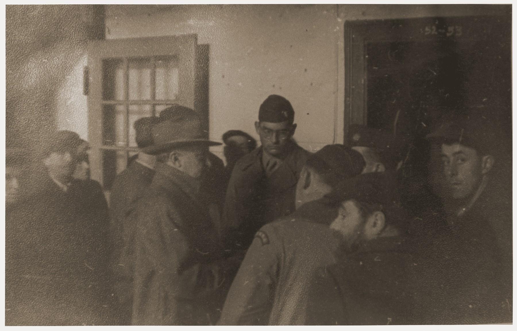 Chaplain Herbert Friedman (center, facing camera) and Philip Bernstein (center left, wearing fedora), Adviser on Jewish Affairs to General Joseph T. McNarney, visit the Berlin-Schlachtensee DP camp.