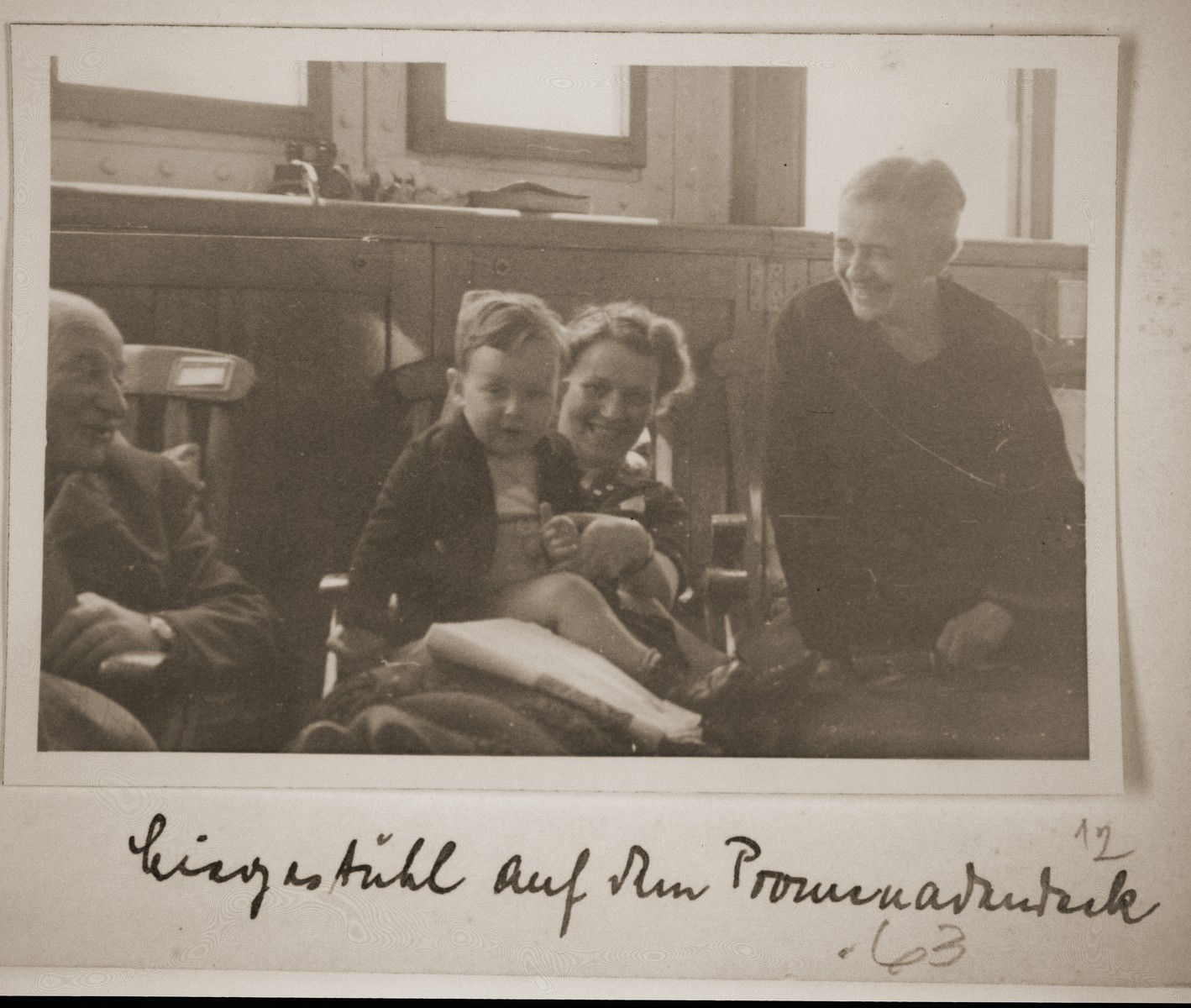 The Vendig family sits on the promenade deck of the St. Louis.