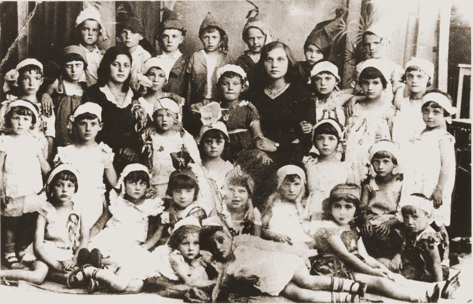 Jewish kindergarten class in Smorgon, Poland.  Those pictured include Leah Kovarski, Etka Rabinovitch, Leika Arotzka, Esther Goldberg, Nechama Ziskovitch, Bela Kovarski, Masha Schwartz, Tania Marcus, Rachel Yentes and Masha Levine.  Only the last three survived.