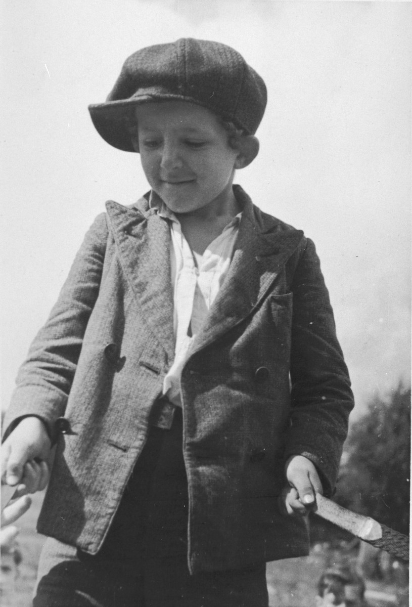 Portrait of a little Jewish boy from Germany at a Kinderlager [children's recreational summer camp] in Horserod, Denmark.    In 1935-36 Norbert Wollheim was involved in organizing groups of German Jewish youth to attend a summer camp in Denmark.