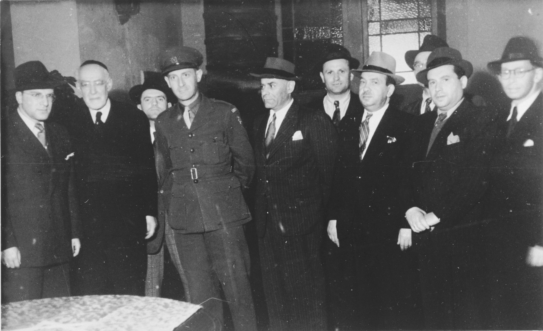 Rabbi Leo Baeck poses with a group of Jewish leaders during his three week visit to Germany.  Norbert Wollheim stands at the far left next to Baeck.  Baeck was greeted at the airport by Norbert Wollheim, Chairman of the Central Committee of Jews in the British Zone.  Baeck's trip included participation in an evangelical congress in Darmstadt on October 12, as well as numerous appearances before local Jewish communities.