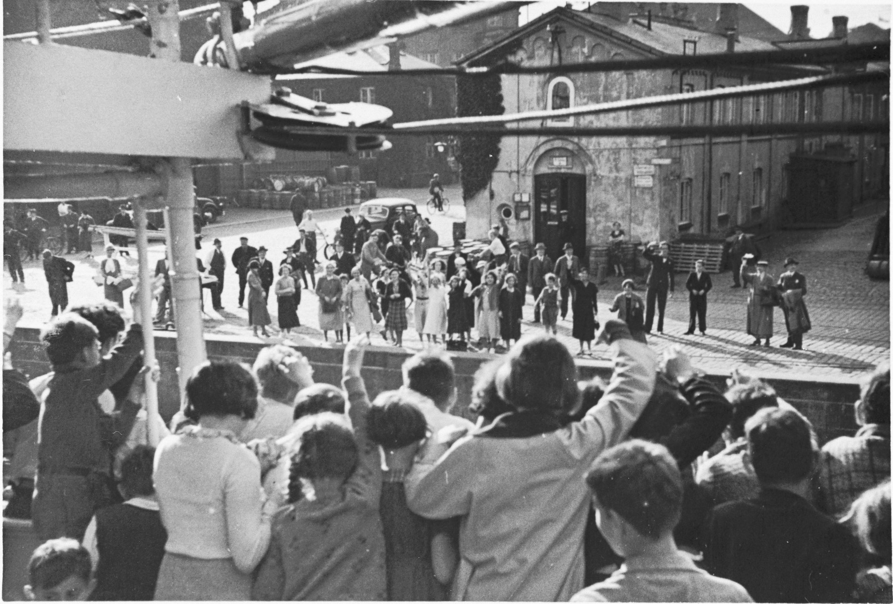 A group of Jewish children from Germany wave to their Danish hosts from the deck of the ship that is taking them home after their stay at a Kinderlager [children's recreational summer camp] in Horserod, Denmark.    In 1935-36 Norbert Wollheim was involved in organizing groups of German Jewish youth to attend a summer camp in Denmark.