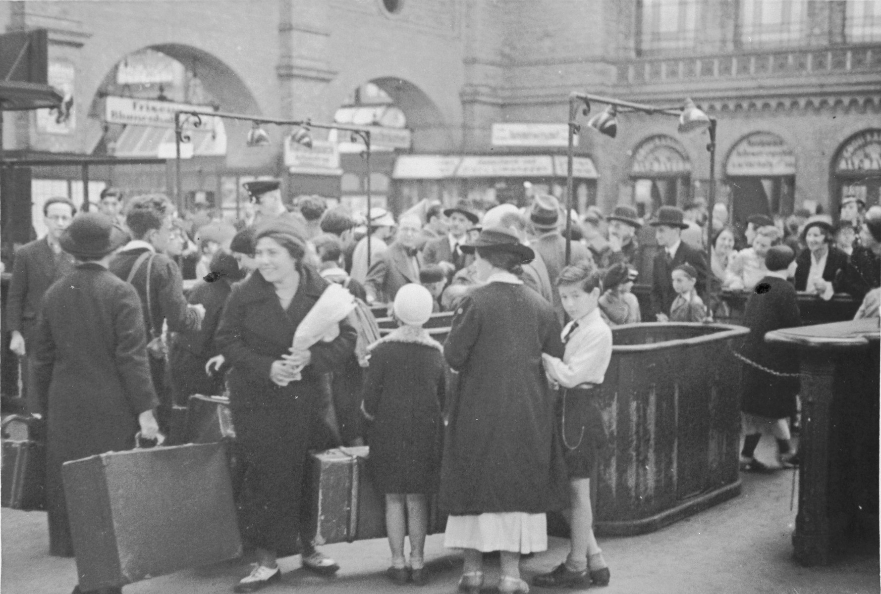 A group of Jewish children from Germany are reunited with their families at the train station in Berlin after their stay at a Kinderlager [children's recreational summer camp] in Horserod, Denmark.    In 1935-36 Norbert Wollheim was involved in organizing groups of German Jewish youth to attend a summer camp in Denmark.