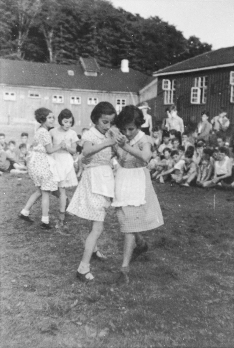 Jewish children from Germany attend a dance class at a Kinderlager [children's recreational summer camp] in Horserod, Denmark.    In 1935-36 Norbert Wollheim was involved in organizing groups of German Jewish youth to attend a summer camp in Denmark.