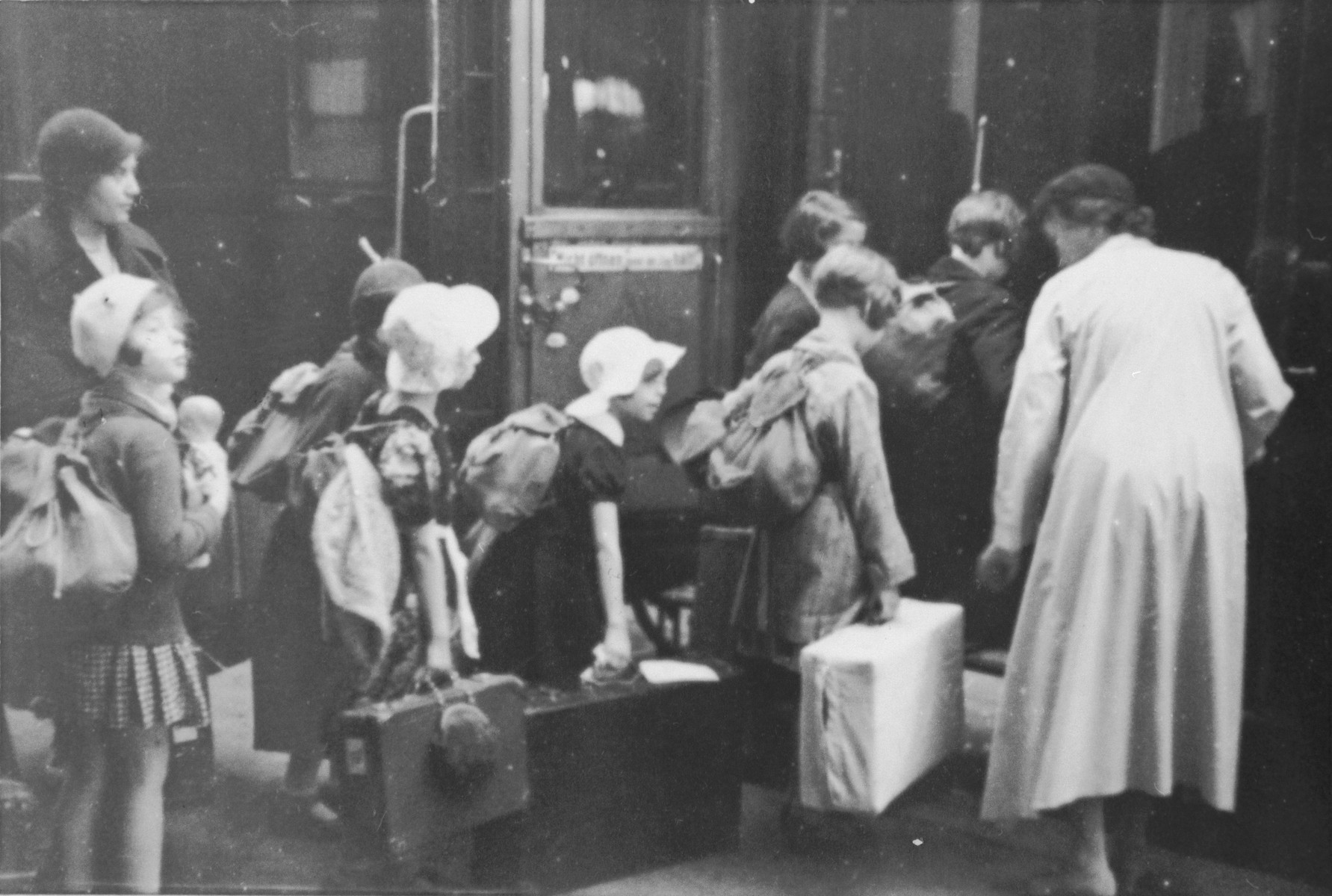 Jewish children from Germany who are on their way to a Kinderlager [children's recreational summer camp] in Horserod, Denmark, board the train with their luggage.    In 1935-36 Norbert Wollheim was involved in organizing groups of German Jewish youth to attend a summer camp in Denmark.