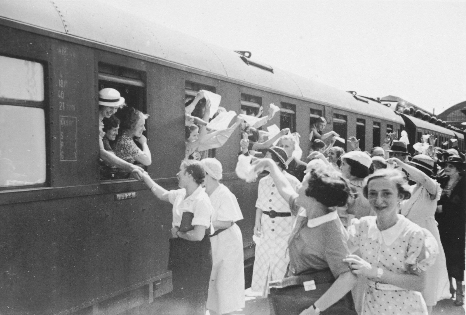 Jewish children from Germany depart by train from a Kinderlager [children's recreational summer camp] in Horserod, Denmark.    In 1935-36 Norbert Wollheim was involved in organizing groups of German Jewish youth to attend a summer camp in Denmark.