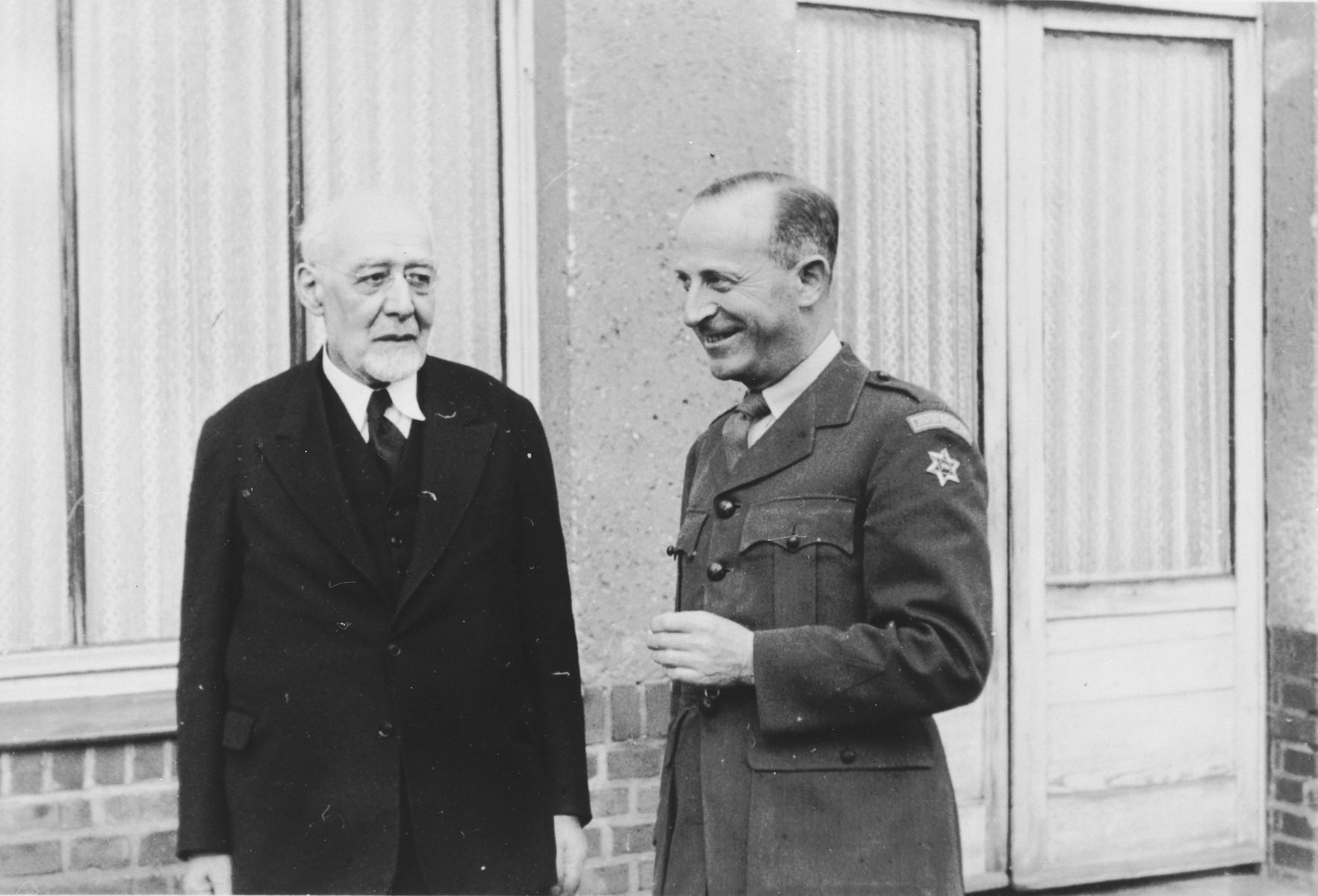 Rabbi Leo Baeck (left) poses with Ernst G. Lowenthal (right) during his three week visit to Germany.  Baeck was greeted at the airport by Norbert Wollheim, Chairman of the Central Committee of Jews in the British Zone.  Baeck's trip included participation in an evangelical congress in Darmstadt on October 12, as well as numerous appearances before local Jewish communities.  Ernst G. Lowenthal was born in Koln, Germany in 1904.  After receiving his doctorate in sociology, he worked for the Central Association of German Citizens of the Jewish Faith from 1929 to 1938.  He also edited the Journal for the History of the Jews in Germany.  In 1939 he immigrated to England.  A year after the war he returned to Germany, where among other roles, he served as director of the Jewish Relief Unit in the British Occupation Zone from 1947 to 1948.