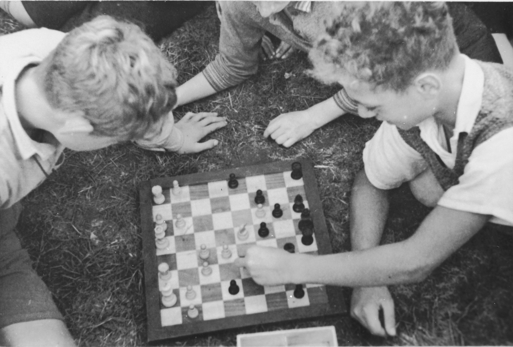 Jewish children from Germany play chess at a Kinderlager [children's recreational summer camp] in Horserod, Denmark.    In 1935-36 Norbert Wollheim was involved in organizing groups of German Jewish youth to attend a summer camp in Denmark.